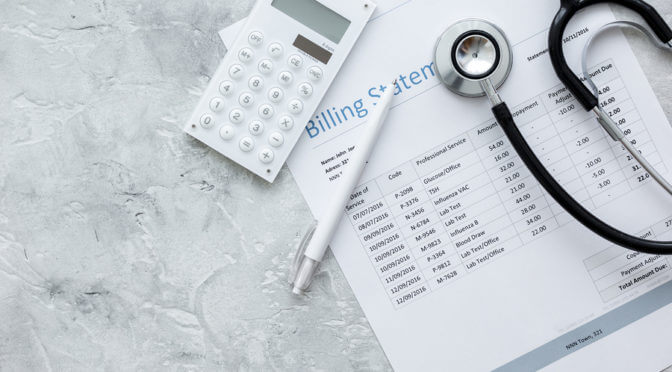 stethescope, calculator, and billing statement